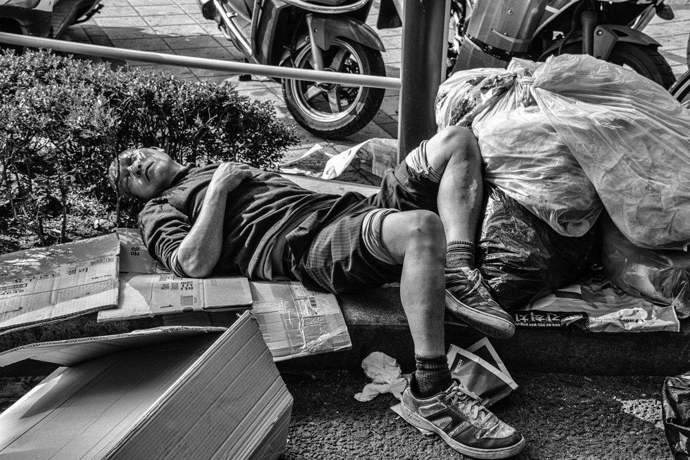 Man asleep on Namdaemun sidewalk - re-edit.JPG