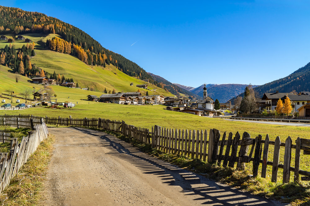 Italy.-Dolomites.-Autumn-landscape-with-bright-colors,-house-and-larch-trees-in-the-sunlight.-692563494_2122x1416.jpeg