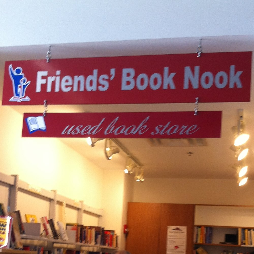 "Image of the sign above the Book Nook Store, reading, ""Friends' Book Nook used book store."""