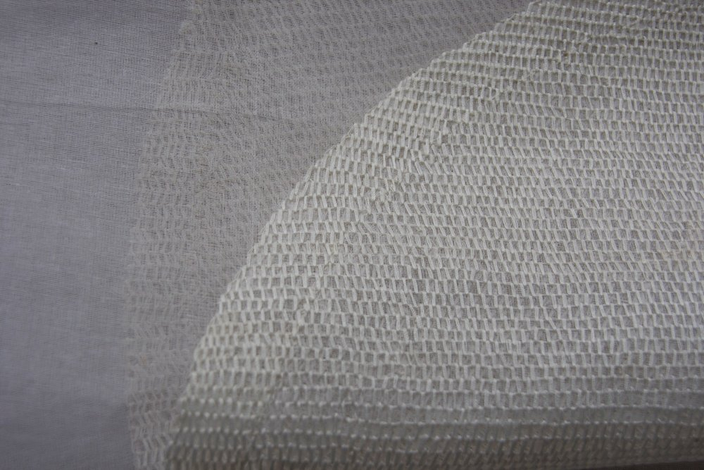 Moon  (Close up)  Honeycomb hand embroidery on cotton Organdy