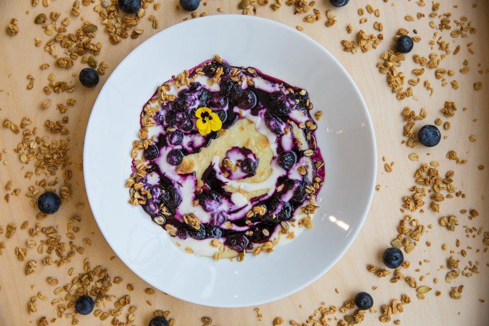 Granola with fresh berries, yoghurt and honey
