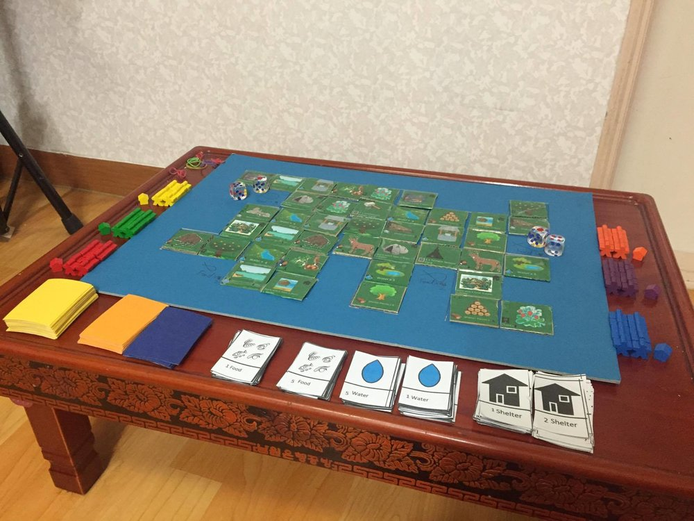 This picture shows all the initial components from the first prototype. Notice the Large board and ugly tiles.