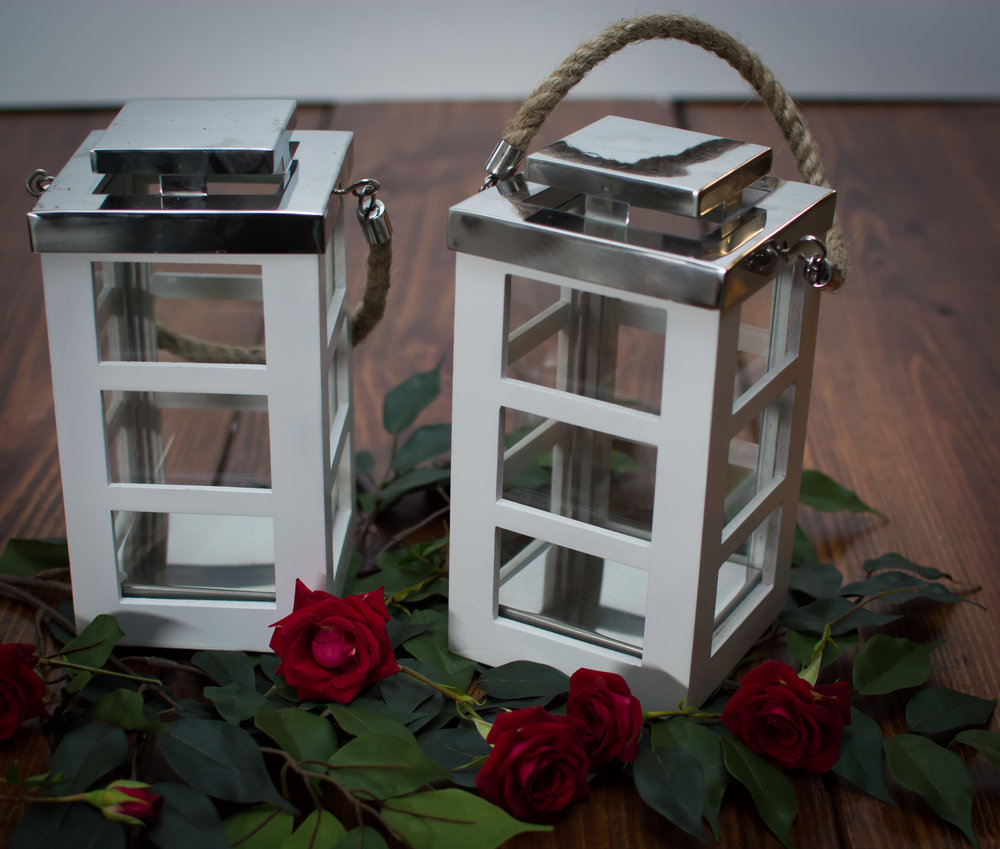 Set of 2 small white Lined Lanterns   Price: $10.00/ $5 Each  Inquire about quantity and availability