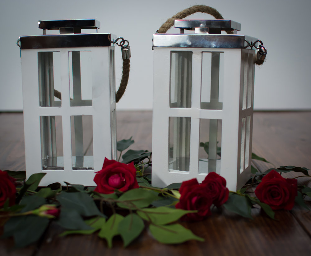 Set of 2 small white Crossed lanterns   Price: $10.00/ $5 Each  Inquire about quantity and availability