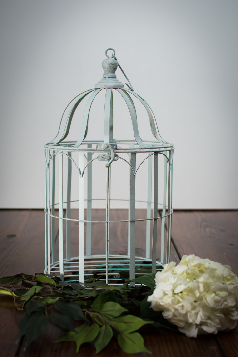 White birdcage   Price: $10.00  Inquire about quantity and availability