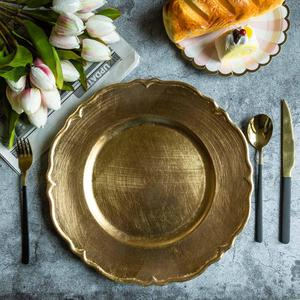 Gold Scalloped charger plate   Material: Acrylic  $1.50 Per Plate  Inquire about quantity and availability