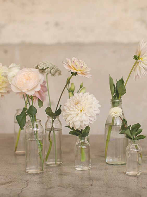 Assortment of Bud Vases   Pricing- Between 1.00-5.00  Colors available: Clear, Blush, Shades of Blue