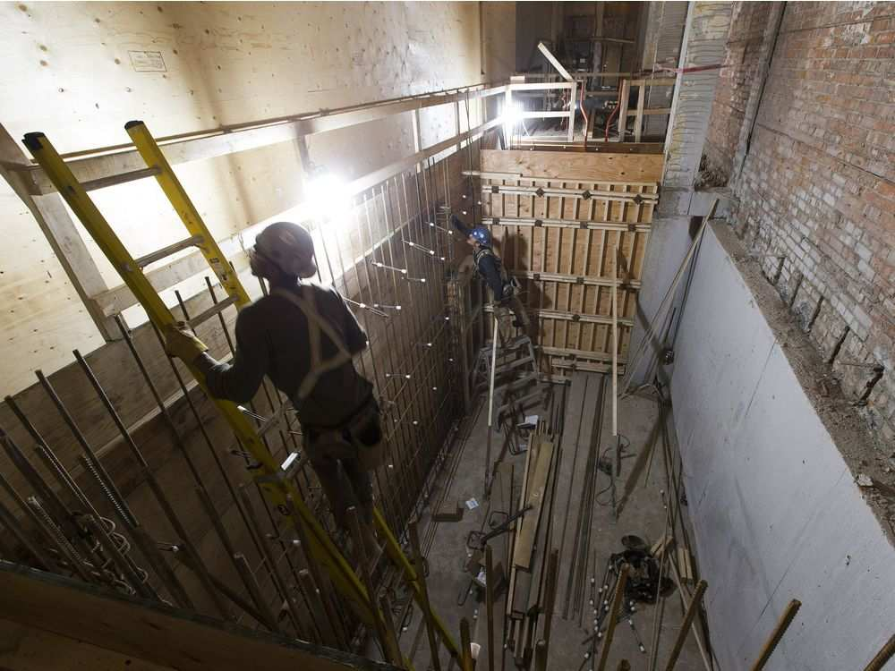 Workers put in rebar in the stair core of the Brighton Block on Friday, June 15, 2018.GREG SOUTHAM GREG SOUTHAM /GREG SOUTHAM