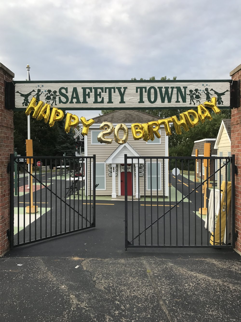 "Sunshine and clear blue skies greeted guests of all ages at the 20th birthday celebration for Safety Town on Saturday, August 26, 2017. -  Guests were excited to see new additions and renovations to the Safety Town site including a full size railroad crossing gate, built and donated by Union Pacific Railroad, and a flagpole.    Union Pacific also honored the little town by designating it an official ""Train Town USA""."