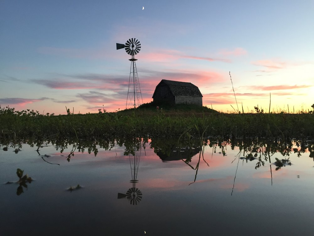 windmill with water at sunset.JPG