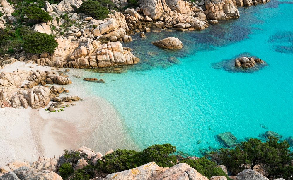 La Maddalena Archipelago - The Maddalena Archipelago is an extremely popular touristic spot due to its breathtaking beaches and engaging lifestyle. Among the islands stands Caprera (in the picture one of its beaches - Cala Coticcio), also known as the place where Garibaldi went in exile.The Maddalena Archipelago can be reached through a short boat trip, from the nearby town Palau.