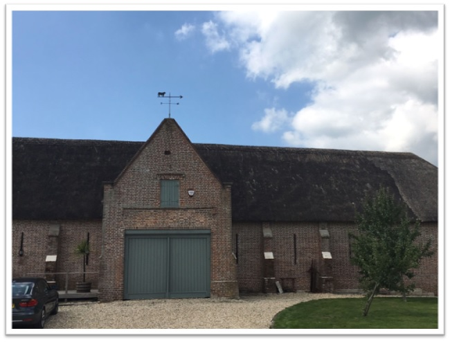 William Holland makes hand crafted baths, basins and more, and stores them all in these gorgeous buildings. The day we were there, a dairy cow came calling, right up to the front door.  Can you believe they are still using thatched roofs?