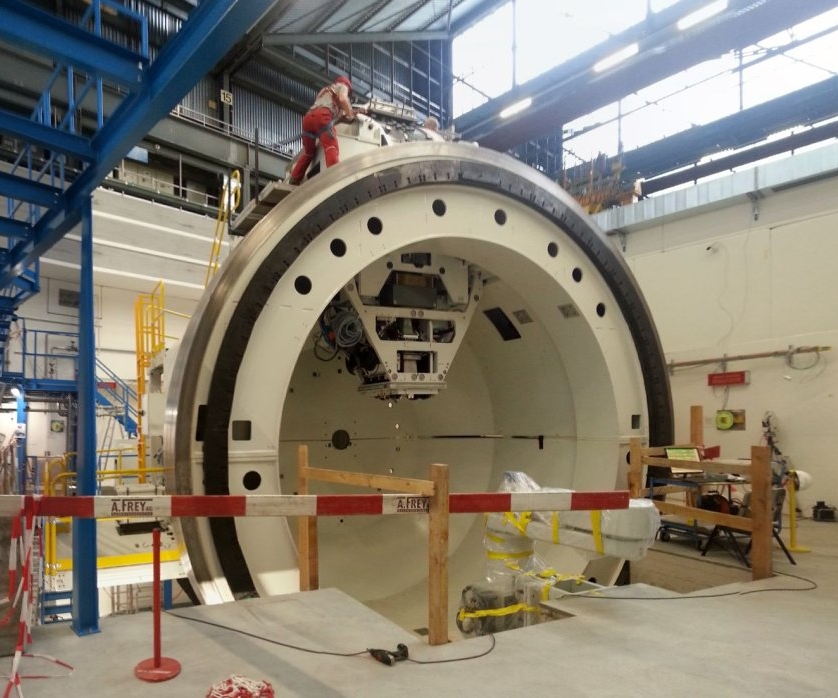 Current Mindset: - Proton therapy gantries are massive, weighing 30-40 tons. The current method for manufacturing such large devices is to build them one at a time in a fixed location