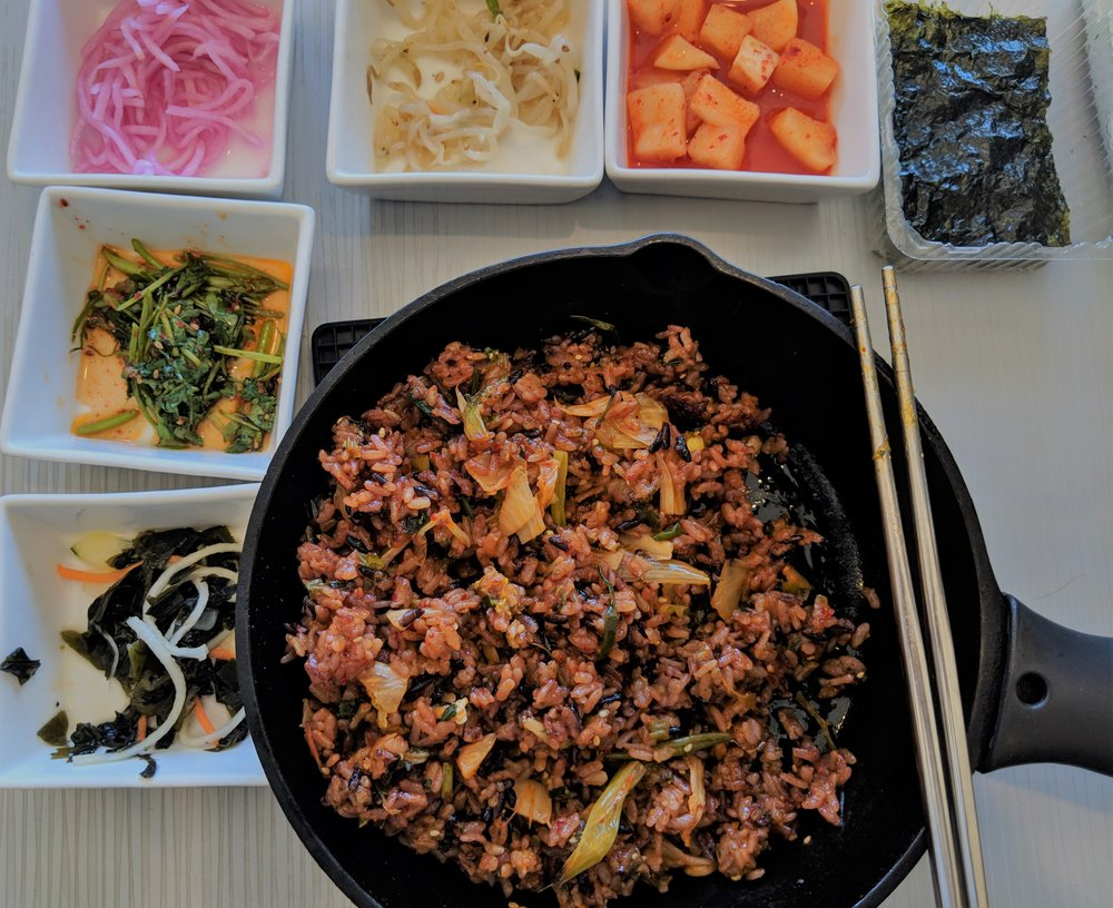 This is NOT a bowl of cold noodles, it is however a piping hot pan of veggie Bibimbap, (mixed rice).