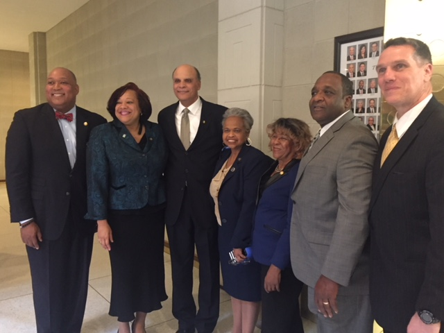 Senator with NC A&T chancellor, athletic director and football coach with Aggie Senators