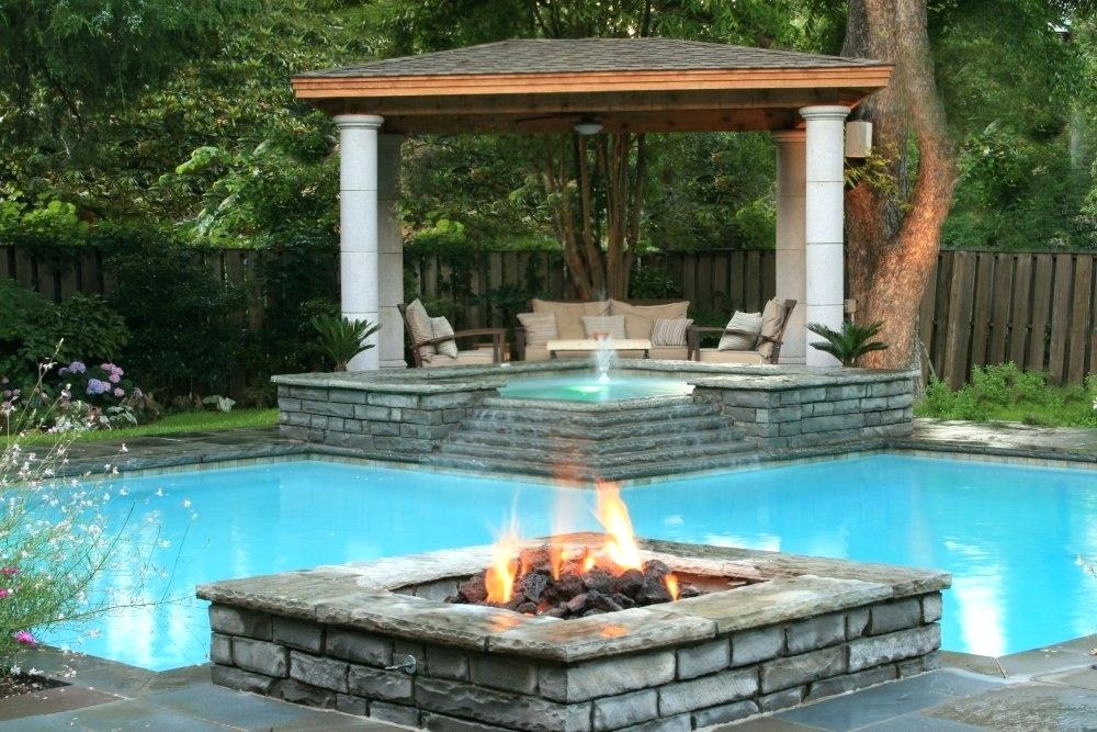 swimming-pool-fire-pit-styled-design-with-paved-rocks-and-a-p.jpg