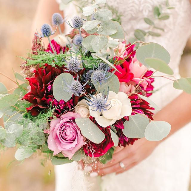 slow flowers for the win in @nicolejprovencher beautiful bouquet!! roses from the amazing @gracerosefarm and the perfect burgundy zinnias from local flower friend @fibonacciflower 😍 📷 : @keeleyabigailphotography . . . . #rusticwildlovely #gtnp #grandwedding #tetonwedding  #jacksonweddings #bitterbrushflowers