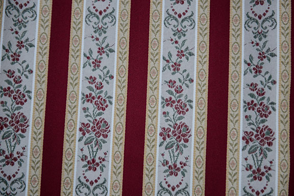 "LESSIRE   WINE              100% POLYESTER                                           108"" WIDE - WASHABLE                                          DECORATION & DRAPERY                                                   MADE IN ITALY"