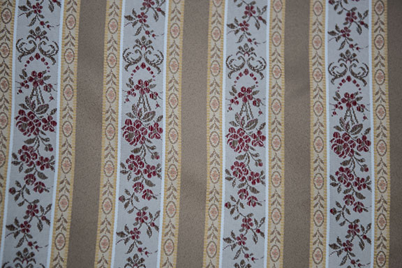 "LESSIRE   GOLD             100% POLYESTER                                           108"" WIDE - WASHABLE                                          DECORATION & DRAPERY                                                   MADE IN ITALY"