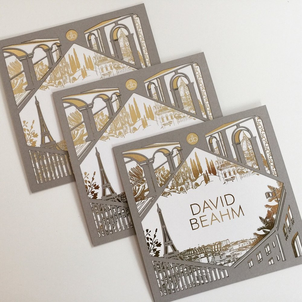 "David Beahm Destinations  \ When inviting guests to the Four Seasons in four European cities, we wanted to help capture the beauty of each destination in one beautiful expression. We designed and laser cut the ""four corners of Europe"" and personalized each invitation in gold foil. The back of the invitation was printed on travertine Chroma."