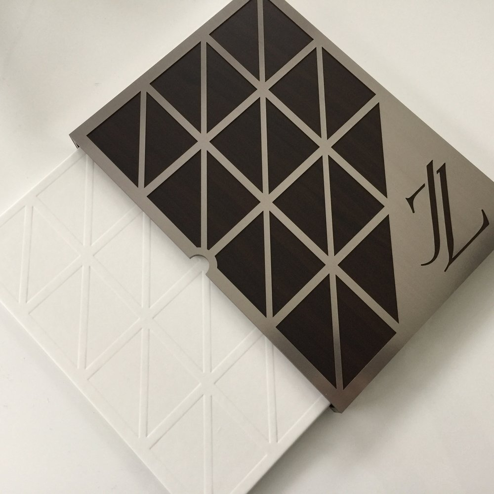 "JZ  \ Inspired by one sharp young man and the architectural lines of  @oneworldnyc , we designed an invitation case comprised of ""Z"" angles and ""steel"" Chroma for JZ's Bar Mitzvah."