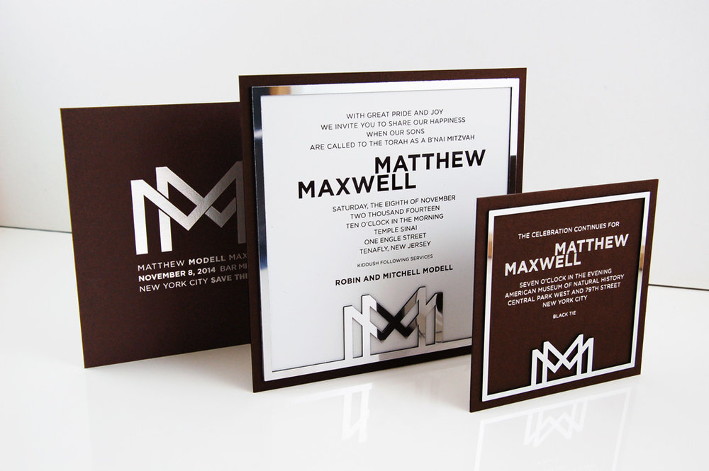 Matthew & Maxwell  \\ MMMMM...this is a good one. Two boys, one letter, and a triple monogram. Then we designed a chrome frame around it and this bar mitzvah invitation turned into a modern, masculine masterpiece.