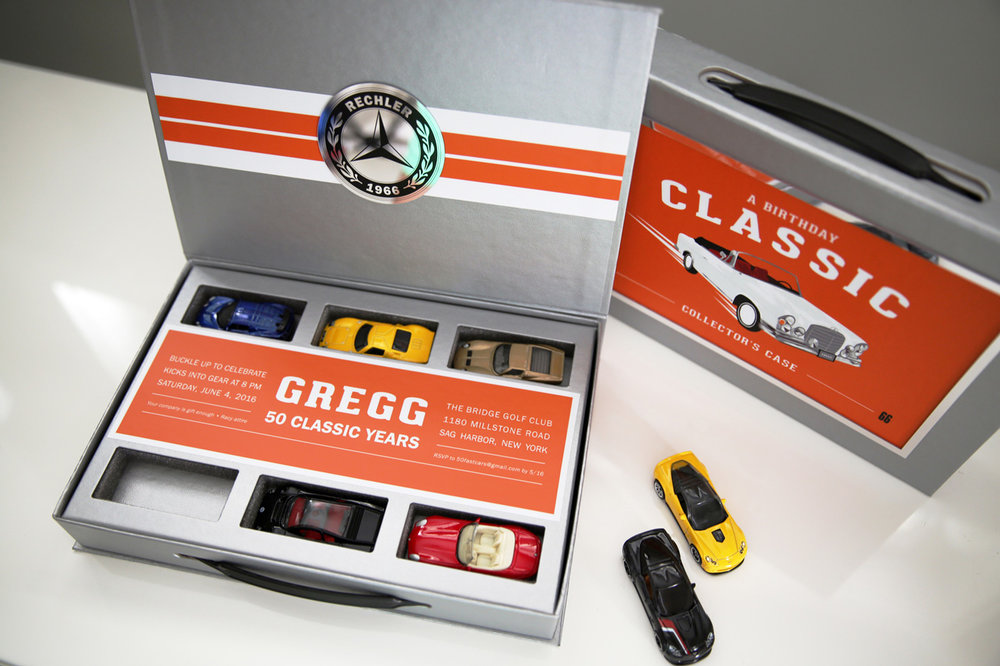 Gregg   \\ When you want to feel like a kid again. Custom Matchbox invitation case with Gregg's car illustrated on front and Mercedes Chroma party medallion. Racy attire of course.