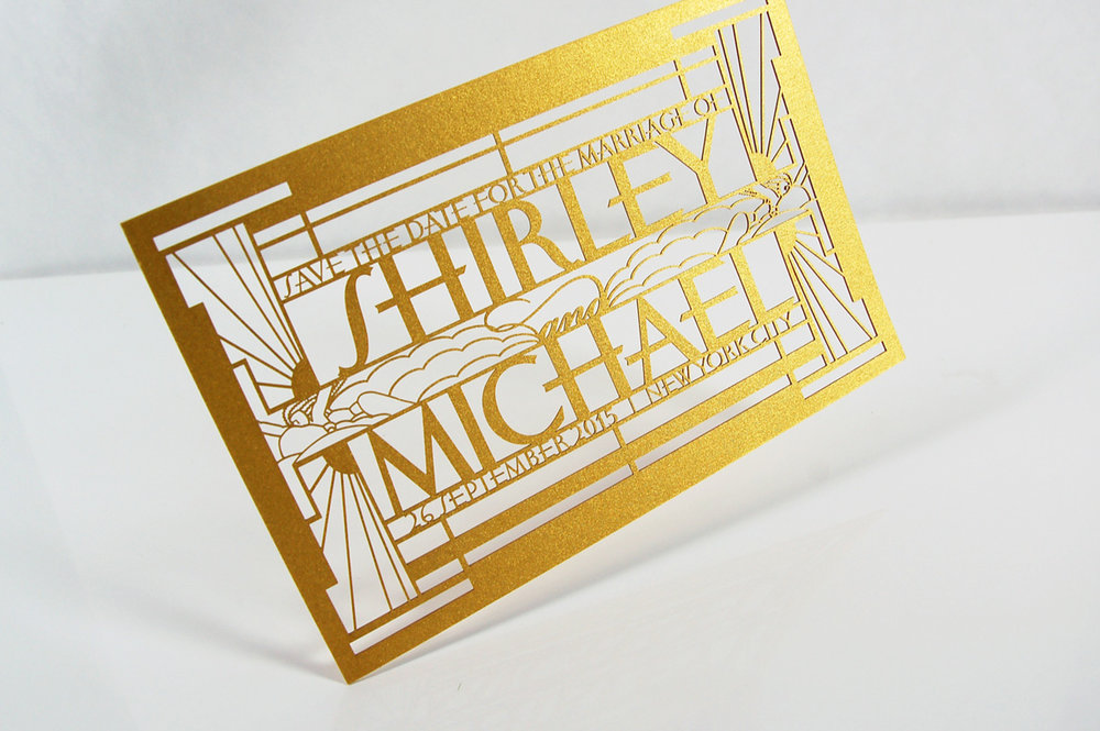 Shirley & Michael  \\ On point. Inspired by the Rockefeller Center Art Deco Frieze and designed using laser cut precision.
