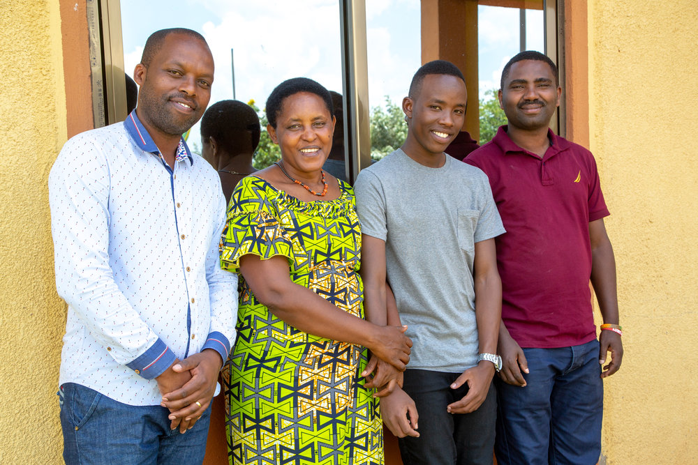 Above, Fils with Health & Wellness Team Leader, Theoneste, his ASYV family mama, Godelieve and his social worker, Emmanuel.