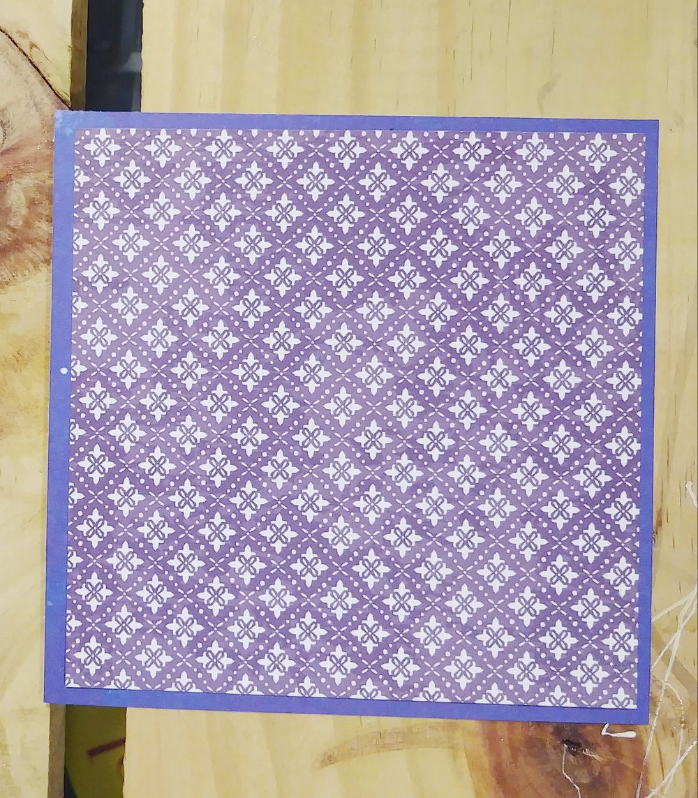 Pattern paper on top of the blue scrap cardstock