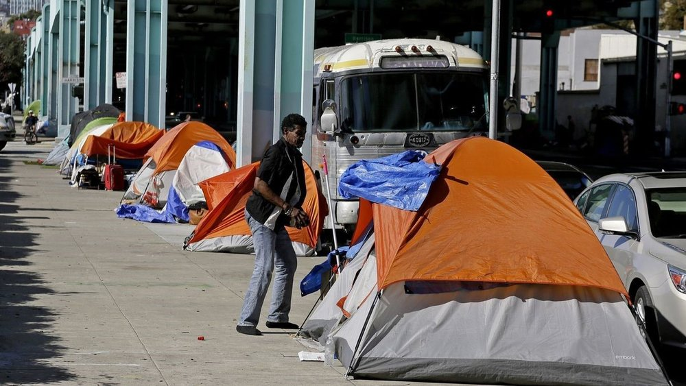 Homelessness, as seen in this 2016 photo from Division Street in San Francisco, is one manifestation of increasing economic inequality. (Eric Risberg / Associated Press)