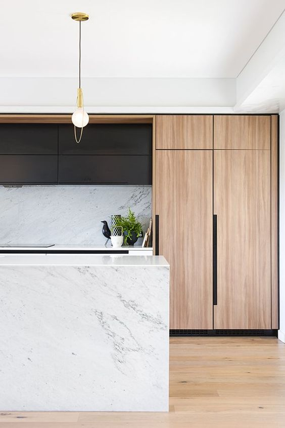 Great use of marble here to keep things looking clean and streamlined. The wrap around the island and the backsplash.