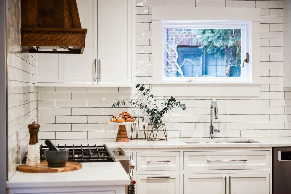 white kitchen wood range hood.jpg