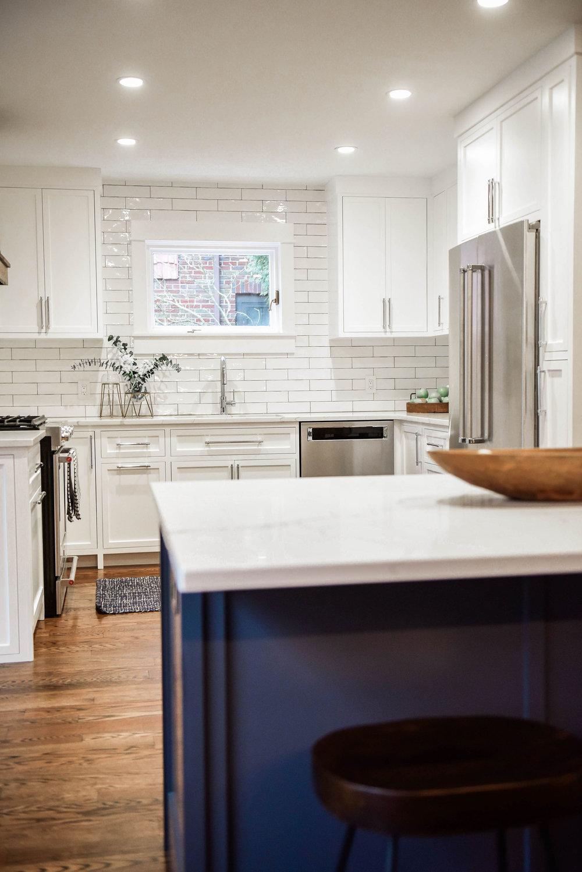 white kitchen with blue island.jpg