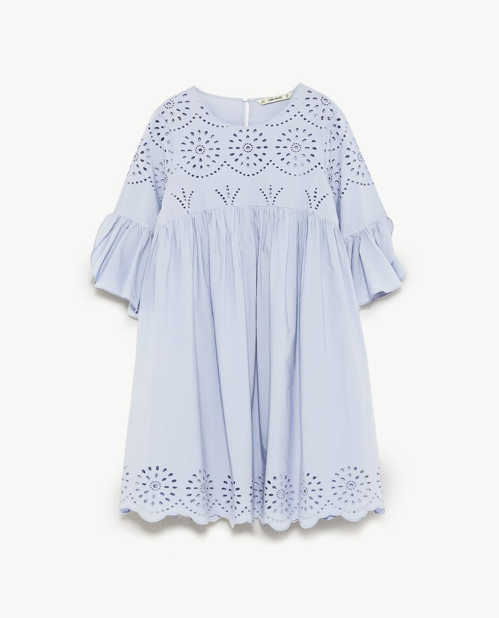 - Lightweight dress with a round neckline and short asymmetric sleeves with wide ruffle trims. Embroidered perforations on the front and hem. Buttoned opening in the back.