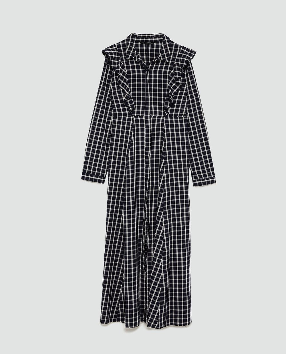- A-line shirt dress with long sleeves. Ruffle trims on the body. Front button fastening hidden by a placket.