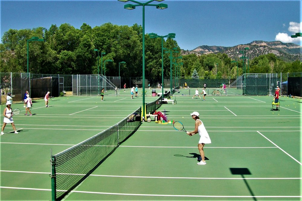 Join our Camps! - Come join in on the excitement of all-level adult tennis and pickleball camps hosted in the quaint Rocky Mountain towns of CO, WY, and NM. Enjoy these high mountain towns with abundant scenery, rivers, and dining.We offer 1 day, 2 day, and 3 day camps with a ratio of 6 to 1 (1 coach per 6 players) as well as private camps at your facility. (contact us for availability).Our goal is to assist you in improving your stroke techniques, doubles and singles strategies, and to give you a competitive edge. Our fast-paced and exciting drills will keep you moving.A Round-robin, supervised by our pros, will be offered to apply the strategies that were practiced during the 3 hour clinic.Campers will be grouped together according to level of experience.We look forward to seeing you on the courts!RESERVE YOUR SPOT!