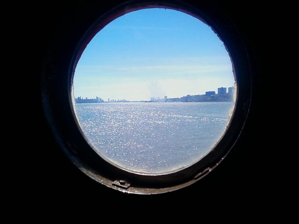 Sparkling view of the Hudson River from the inside of the Little Red Lighthouse.