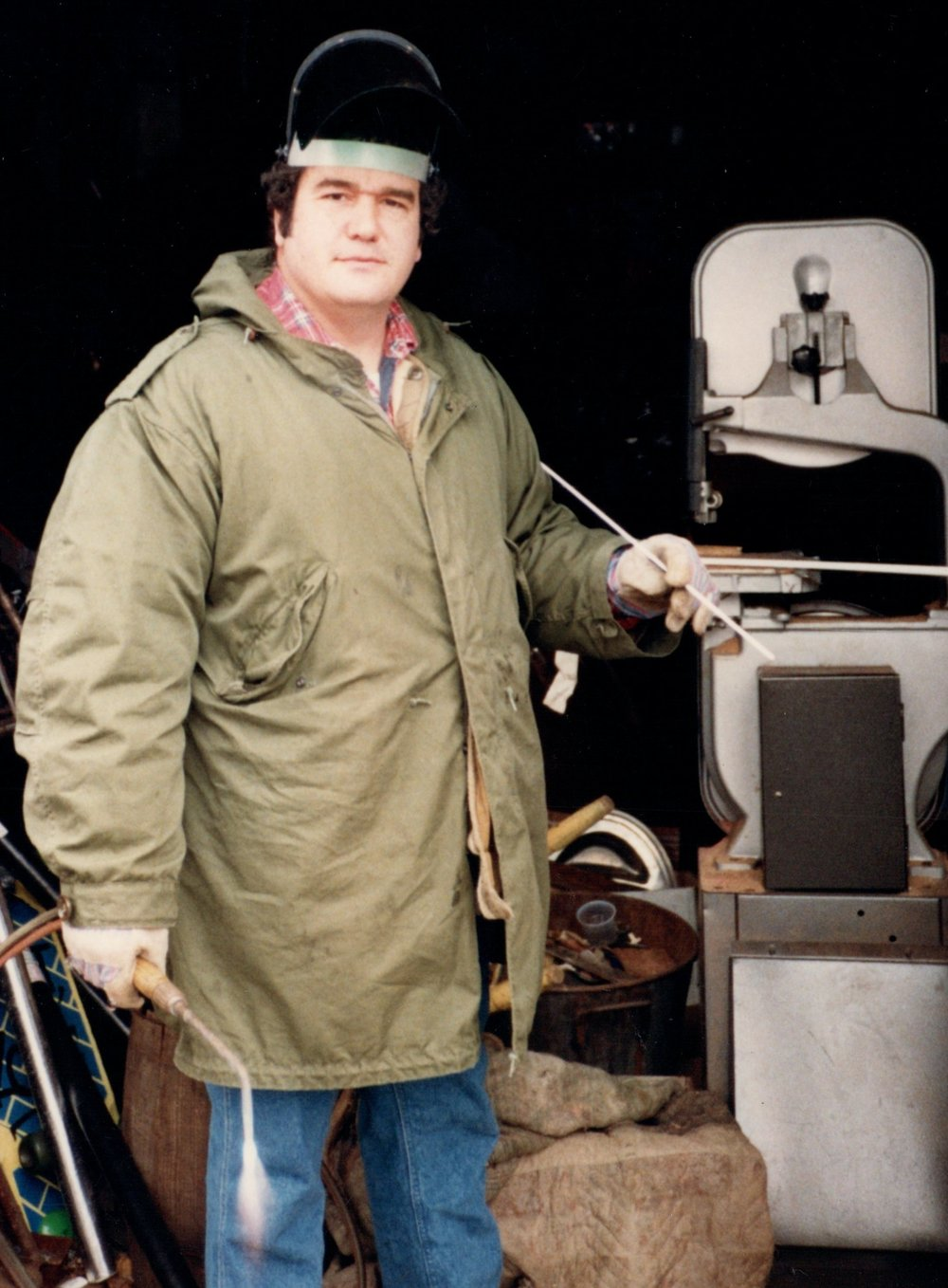 Michael Malpass at work, 1986. The bandsaw in background was used for slicing soft-metal (brass, copper, bronze) pieces.