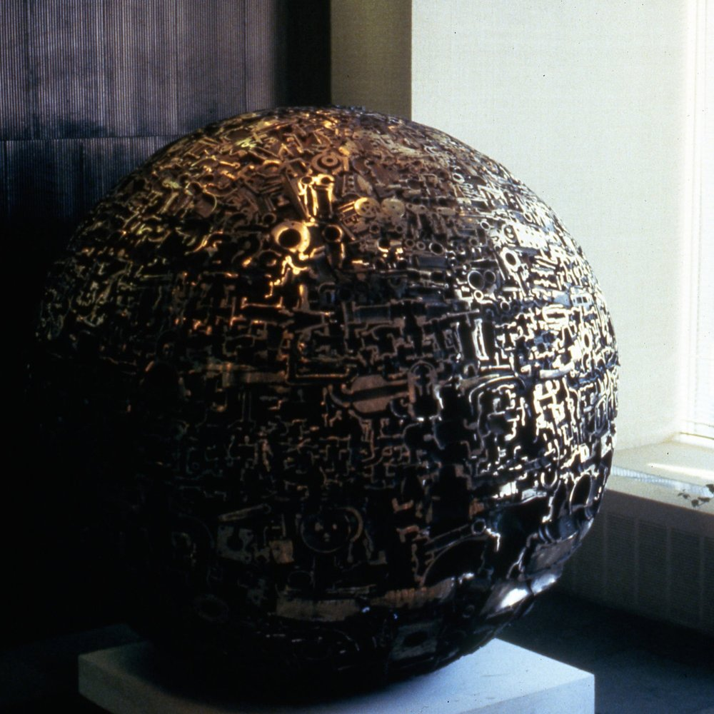 """Sunset Sphere"" by Michael Malpass, 1982. 5' diameter welded bronze sphere. Installation at the General Electric Company, Schenectady, NY."