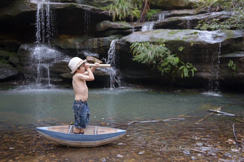 Waterfall, hunts creek, boy in a boat