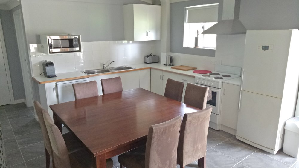 Fully Equipped Kitchen and 8 Seat Dining Table