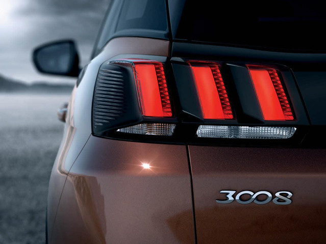 incorporating PEUGEOT 's signature claw effect LED lighting.