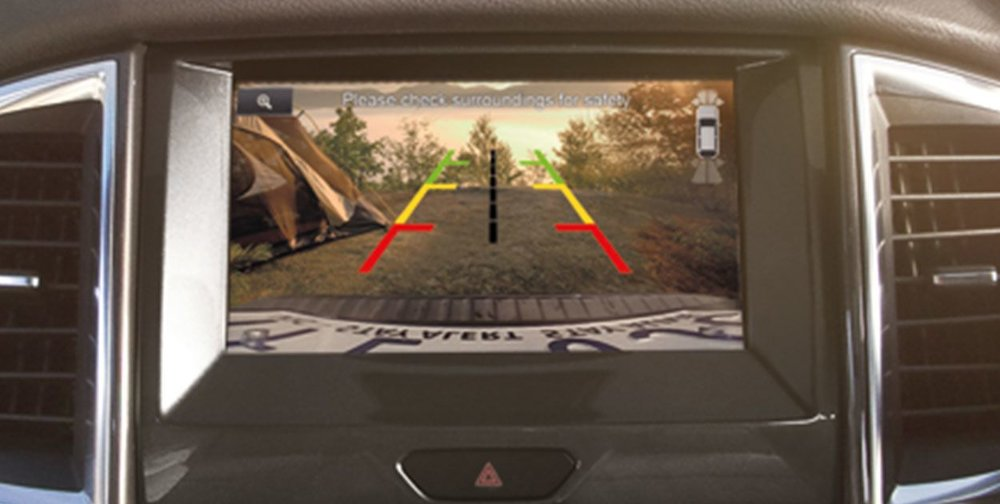 Hands-free parallel parking while watching on rear view camera.