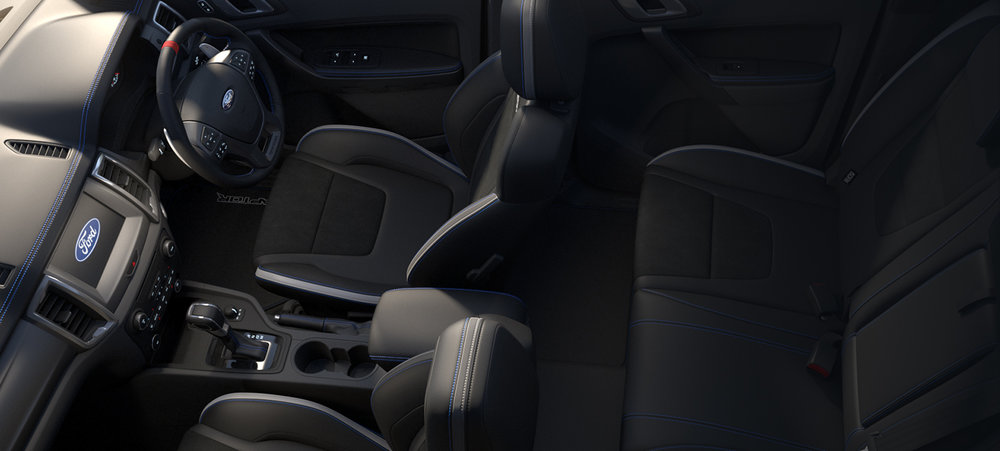 Body-contoured sports seats include unique Raptor head rests, bolsters, and suede inserts for better body grip when driving off-road