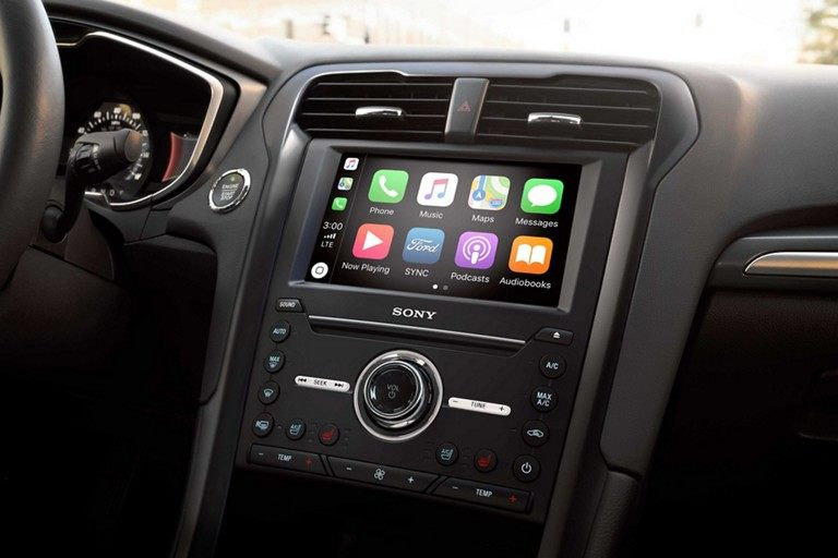 Fusion titanium with standard SYNC voice active technology featuring CarPlay and Android Auto compatibility
