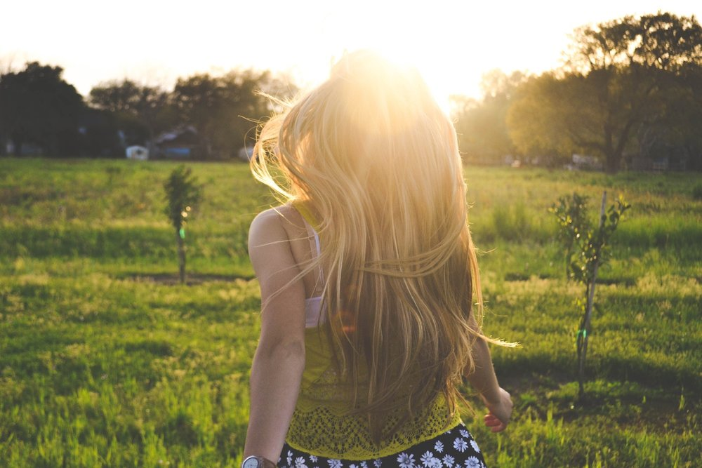 run-away-girl-field-hair-sunshine.jpg