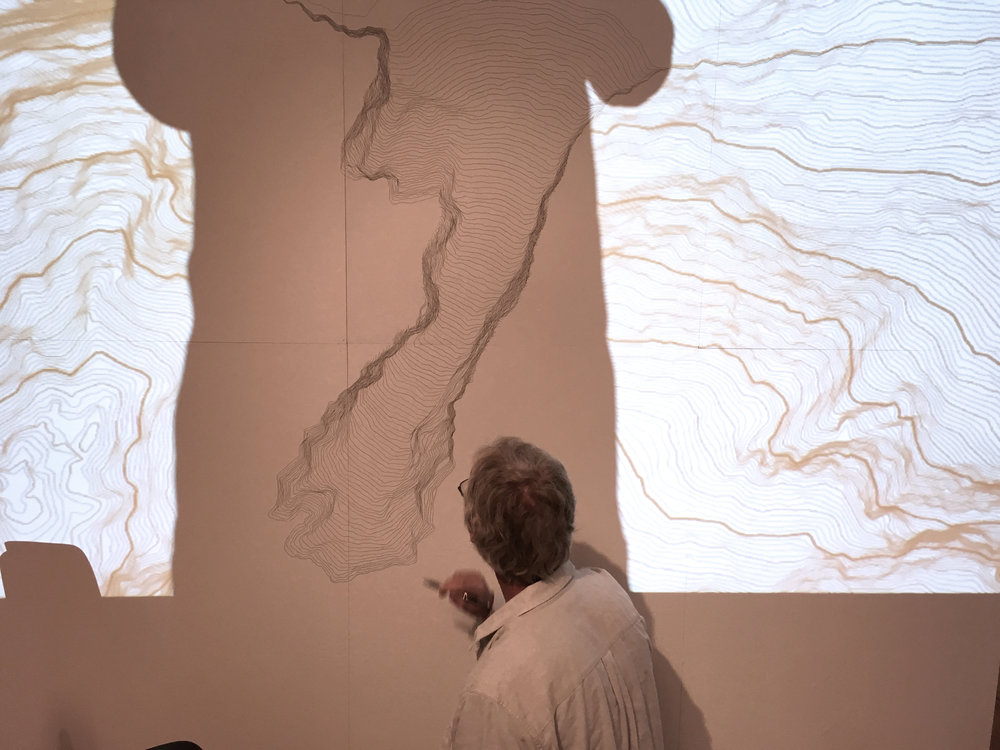 Preparing the exhibition, site specific wall drawing, - section of a map from mountains in the area nearby.