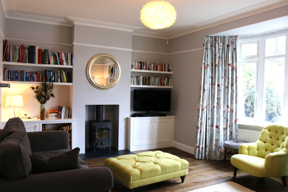 Neutral grey wall colour with contrasting zesty yellow upholstery at Thorpewood Avenue, London SE26