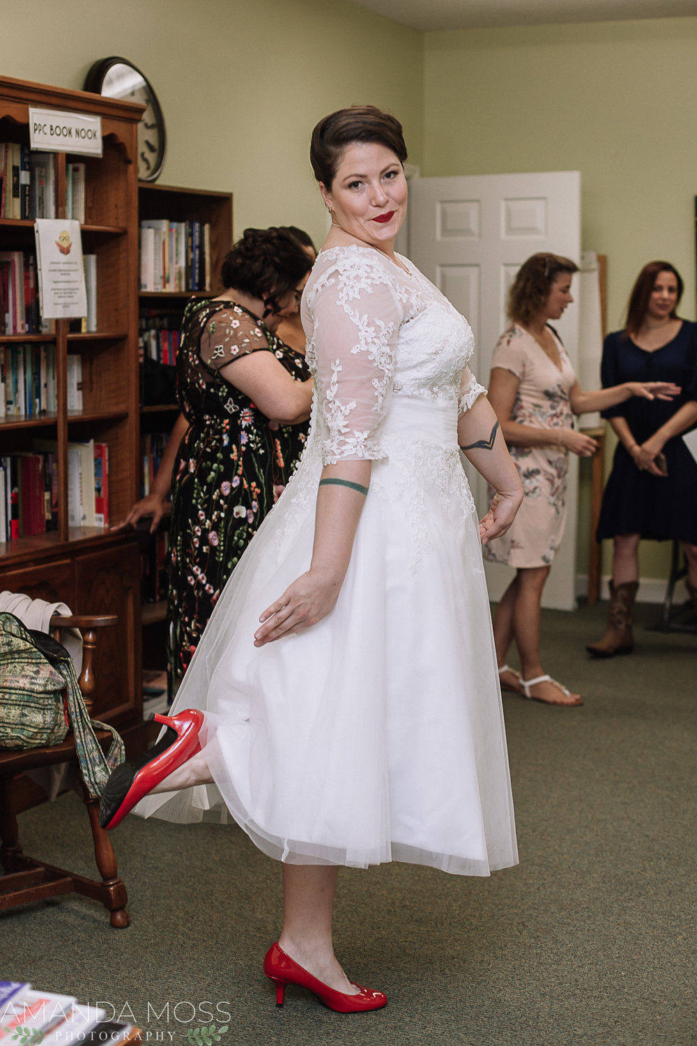 This beautiful bride opted for a bright red, low heeled pump to show off her tea length dress and to provide a POP of color.
